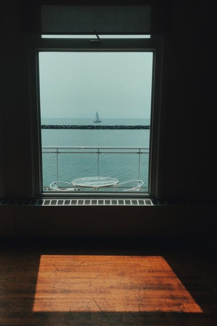 a-boat-through-the-window-in-the-sun.jpg