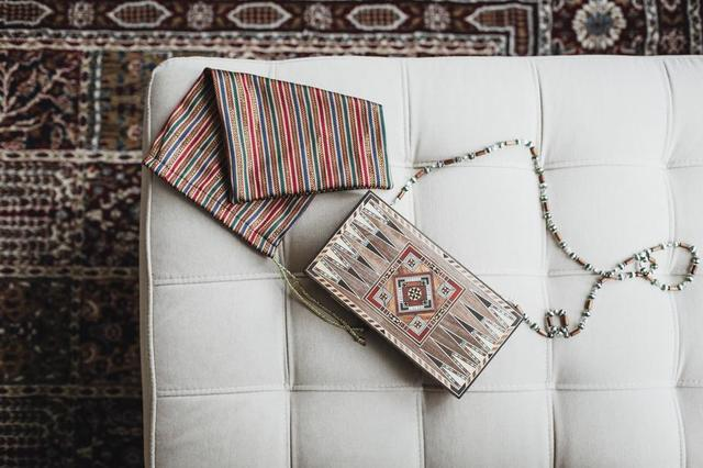 a-wooden-bag-with-a-beaded-handle.jpg