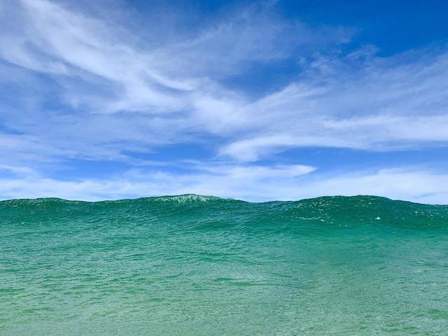 big-ocean-wave-under-blue-sky.jpg