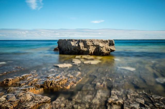 bright-blue-day-water-rock.jpg