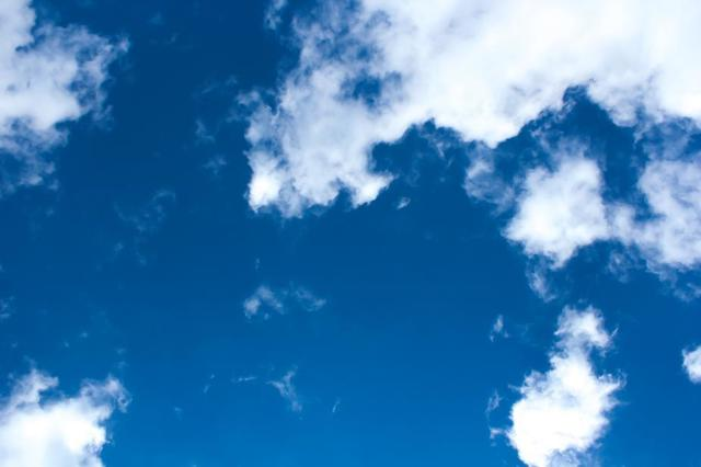 bright-blue-sky-dotted-with-fluffy-white-clouds.jpg