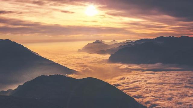 cascading-clouds-surrounding-hilltops-at-sunset.jpg