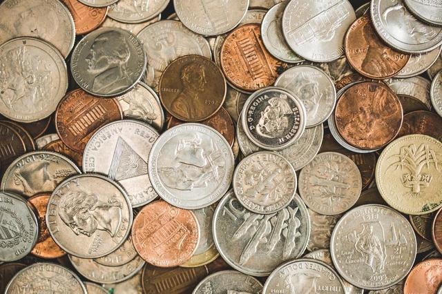 coins-spread-out-pile.jpg