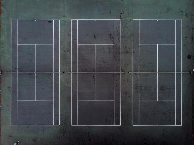 drone-view-of-three-tennis-courts.jpg