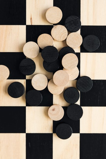 game-board-with-checkers-pieces-spread-out.jpg