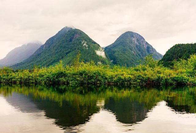 landscape-shot-of-green-mountains-below-foggy-sky.jpg
