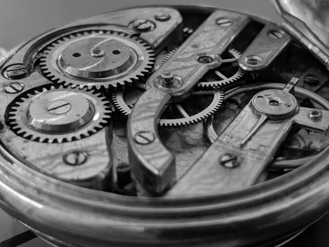 open-timepiece-exposing-cogs-and-gear-wheels.jpg