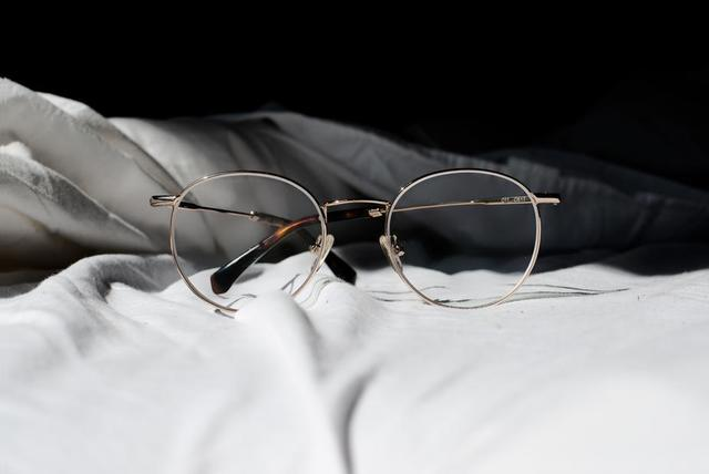 pair-of-glasses-on-a-bed.jpg
