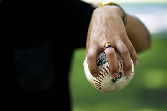 rainbow-ring-on-hand-holding-softball.jpg