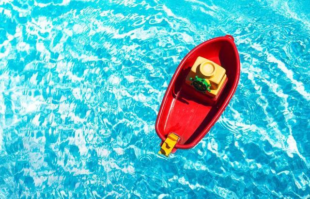 red-toy-boat-in-a-swimming-pool.jpg