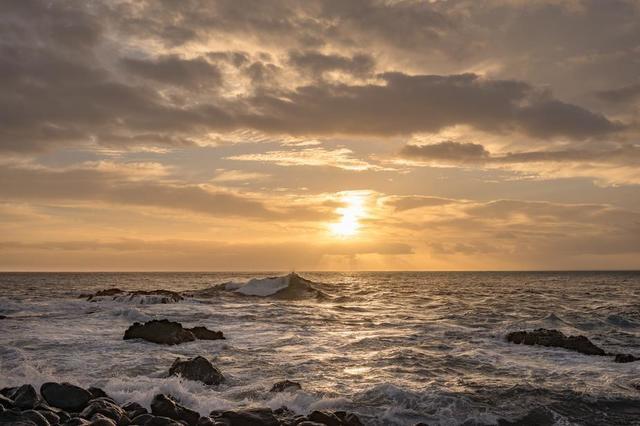 sunset-as-waves-crash-on-rocky-shore.jpg