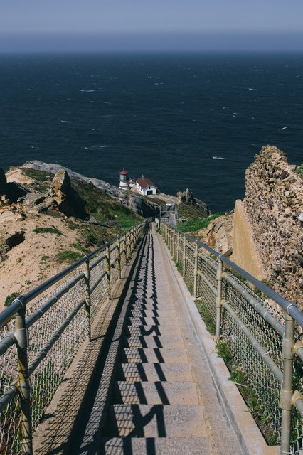 walking-bridge-to-lighthouse-by-pacific-ocean.jpg