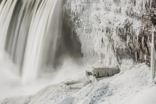 water-falls-over-icey-rockface.jpg
