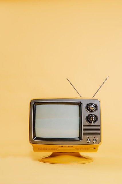yellow-tv-set-on-monochromatic-seamless-backdrop.jpg